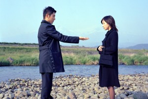 "Peace offering · Masahiro Motoki (left) and Ryoko Hirosue (right) star as husband and wife in Yojiro Takita's ""Departures,"" a contemplative drama that examines the lives of nokanshi, the preparers of corpses."