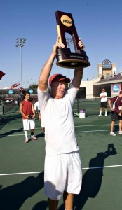 First at last · USC men's tennis coach Peter Smith hoists the NCAA team championship trophy, USC's 17th but Smith's first. Coaching since he was 23, Smith had stints at three schools before he came to USC. - Photo courtesy of USC Sports Information