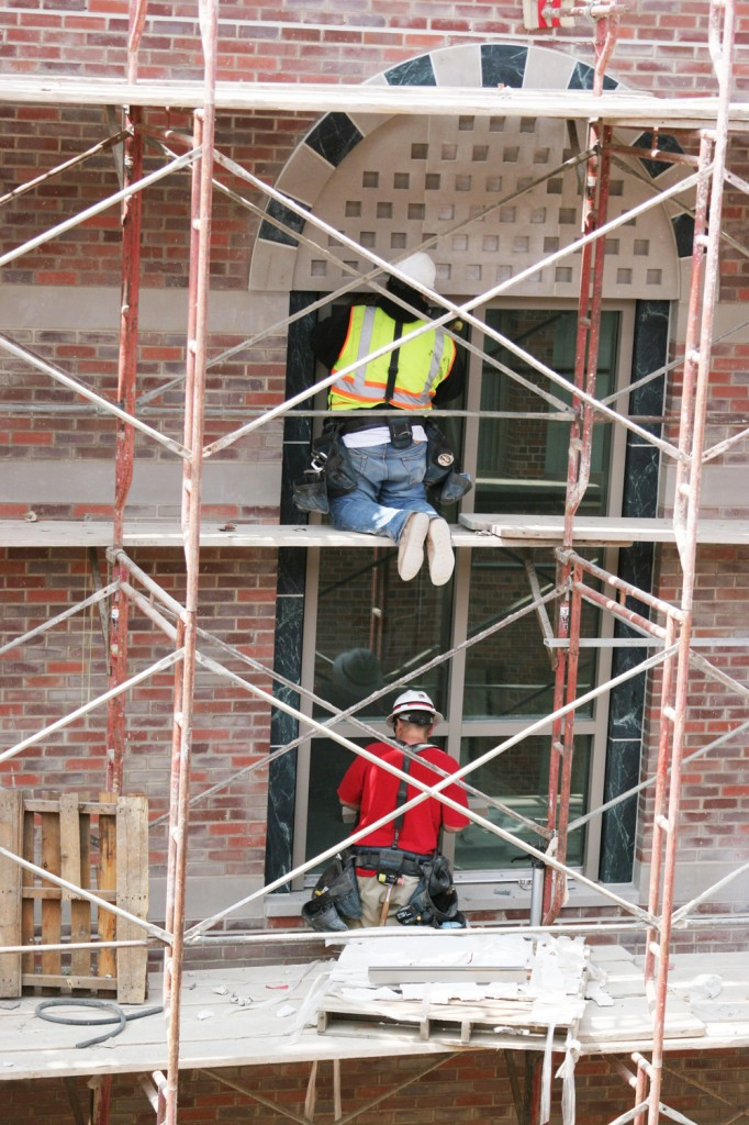 Workers install windows at the new Ronald Tutor Campus Center, which has undergone construction since the project broke ground in April 2008. The four-story, $120-million complex, which replaced Commons, is projected to be ready for student use by the fall semester of 2010.
