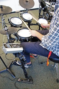 (left) A student practices in the Roland Drum Lab, which was installed on campus last spring. - Photos Courtesy of the Thornton School of Music