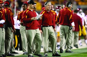 Shared wisdom  · Steve Sarkisian (left), the play-caller for the Trojan offense for the past two seasons, brought many of the lessons he learned from Pete Carroll to his new head coaching job at Washington.  - Photo courtesy of USC Sports Information