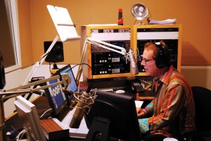 On air · Alan Chapman, a host for KUSC, sits behind the control booth at the LA studio. KUSC is the most listened to public radio station. - Geo Tu | Daily Trojan