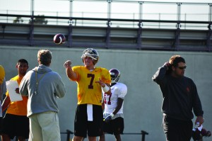 No questions asked · Matt Barkley, who is certain that he will be available to play this week, tossed a ball with Pete Carroll during practice. - Mannat Saini | Daily Trojan