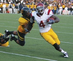 Junior running back Joe McKnight bounces out of a tackle from a Cal defender in USC's 30-3 win against Cal on Saturday.