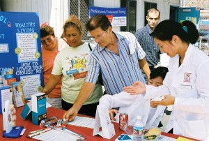 Healthy giving · Visitors stop by a booth at the Community Health Fair, which received a $14,000 grant from the Good Neighbors Campaign. -  Photo courtesy of Carolina Castillo