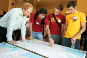 Right lane · Jared Shier (right) and Eric Bruins, members of the USC Cycling Club,  discuss LADOT's proposed bicycle plan at an interactive public workshop Saturday. - Carlo Acenas | Daily Trojan