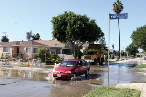 Old black water · A car plows through the water flooding the intersection of 83rd and Wall streets after a water main break on Tuesday. The USC Center on Megacities is working with the LA Department of Water and Power to find the source of the main breaks. - Mike Lee | Daily Trojan