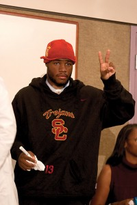 "Heading home · Stafon Johnson flashes the ""Fight On"" sign at the press conference a few weeks after his emergency surgery. - Dieuwertje Kast 