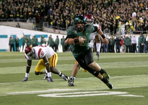 Running wild · Oregon quarterback Jeremiah Masoli torched the Trojan defense on the ground, rushing for 164 yards and one touchdown. - Dieuwertje Kast | Daily Trojan