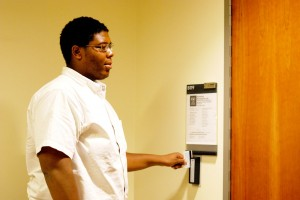 Open sesame · Iwari DeWees, a senior majoring in mechanical engineering, uses his keycard to enter the Biomedical Microsystems Lab. - Geo Tu | Daily Trojan