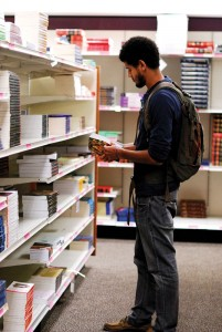 Browsing · Chris Pryor, a sophomore majoring in English, looks at textbooks at the Pertusati Bookstore. -Geo Tu | Daily Trojan