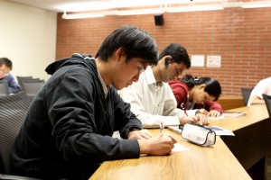 Evaluating · Yinghua Zhu, a second-year graduate student studying electrical engineering, fills out an evaluation of his professor. Evaluations are used in performance reviews. - Amaresh Sundaram Kuppuswamy | Daily Trojan