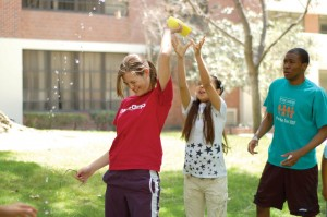 Can do · Members of Troy Camp pass water balloons at their water-themed fun day. Troy Camp will be fundraising with Pass the Can Saturday. - Minnie Jan | Daily Trojan