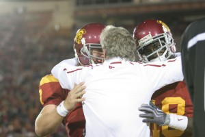 Pete hugs Barkley and Damian after the final touchdown in the fourth quarter that Damian Williams scored. - Dieuwertje Kast | Daily Trojan