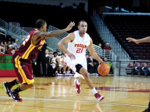 On his shoulders · If the Trojans hope to continue any of their recent success, it will start with senior guard Dwight Lewis. - Young Kim   Daily Trojan
