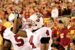 Unwelcome guests · Mark Bradford (4) and Anthony Kimble celebrate Stanford's shocking 24-23 win over USC in the Coliseum in 2007. Bradford caught a last-minute touchdown from Tivita Pritchard to break USC's 35-home game winning streak. - Joel Zink   Daily Trojan