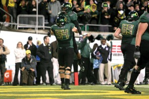 Passing the torch · Oregon's Jordan Holmes lifts LaMichael James after a touchdown in a game that saw the Ducks dethrone USC. - Dieuwertje Kast | Daily Trojan