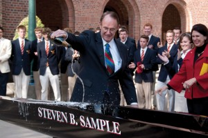 Wine to water · The men's club crew team christened their new shell, the Steven B. Sample, in front of Bovard Auditorium on Wednesday. The team decided to dedicate the shell to the outgoing president in honor of his 19 years of leadership at USC. - Dieuwertje Kast | Daily Trojan