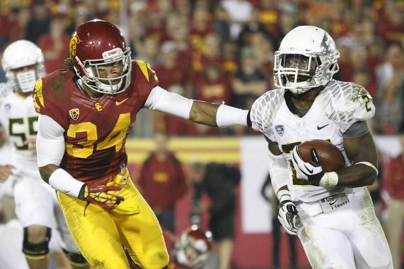 USC's Tony Burnett pursues Oregon's Kenjon Barner