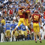 USC celebrates a sack on UCLA QB