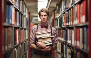 Book smart · Librarian Trevor Nelson, a sophomore majoring in mechanical engineering, stands inside the Doheny Library bookstacks. - Ralf Cheung | Daily Trojan
