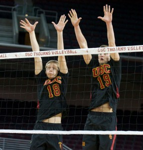Aiming high · Freshman middle blocker Josh Kirchner (18) and redshirt sophomore outside hitter Joey Booth go for the block at the net. - Ralf Cheung   Daily Trojan