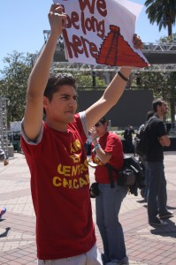 """We belong here"" · Edgar Aguilar, a senior majoring in theatre, protests the relocation of  El Centro Thursday near Tommy Trojan.  - Rachel Bracker 
