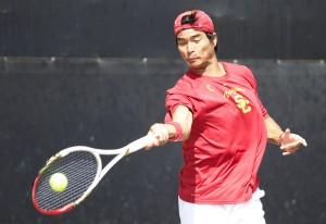 For country · USC junior Ray Sarmiento of the men's tennis team will lead a coalition of members from both the men's and women's tennis teams as they compete for America at the World University Games. - Ralf Cheung | Daily Trojan