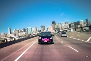 Need a Lyft? · The app Lyft helps students find a ride, and drivers are oftentimes distinguished by the pink mustaches on their cars. - Courtesy of Lyft
