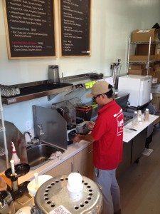 Mixing it up · Owner Leaf Ye blends L.E.N.O.'s most popular food item, the acai bowl, for a customer. In addition, L.E.N.O. also offers a popular kale salad and fresh cut fruits in its refrigerator display case. - Euno Lee | Daily Trojan