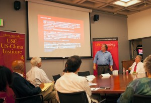 Media Blitz · Director of the USC U.S.-China Institute Clayton Dube speaks in front of panelists about the media coverage of the widely publicized meeting between President Obama and President Xi of China.  - William Ehart | Daily Trojan