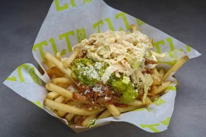 Not so small fries · TLT Food's shareable appetizers bring bold combinations of flavors to the forefront. The carnitas fries (pictured above) include carnitas slow-cooked for 12 hours and topped with a dollop of guacamole.  - Courtesy of Entertainment Fusion Group