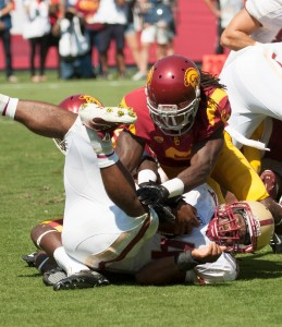 Eating turf · Redshirt junior cornerback Josh Shaw secures a tackle against Boston College senior running back Andre Williams in the Trojans' 35-7 victory over the Eagles at the Coliseum last Saturday. - William Ehart | Daily Trojan