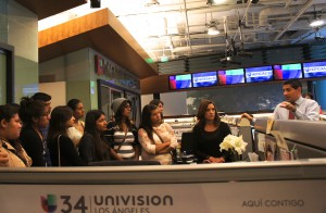 """Television tutelage · USC's National Academic Initiative scholars tour the Univision headquarters and meet with on-air personalities Cecilia Bogran and Alejandro Mendoza of """"Primera Edicion."""" - Photo courtesy of USC"""