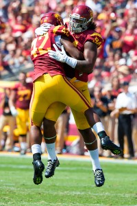 Embrace · Redshirt sophomore defensive end Leonard Williams (94) and redshirt senior linebacker Devon Kennard (42) celebrate a defensive stop. - Ralf Cheung | Daily Trojan