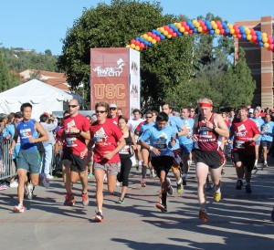 Run this city · Runners representing USC and UCLA compete at last year's We Run This City 5K. The event pits the fundraising efforts of the two rival schools against one another to raise money for the Special Olympics. - Photo courtesy of Special Olympics of Southern California