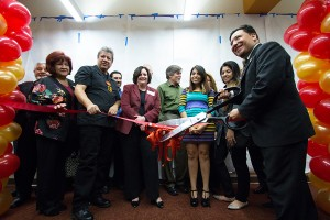 Chop, chop · Bill Vela, director of El Centro Chicano, cuts the ribbon at the grand opening of El Centro's new location in the Gwynn Wilson Student Union. Students, faculty and alumni attended the event.  - Nick Entin | Daily Trojan