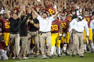 Making his mark · USC interim head coach Ed Orgeron celebrates during the Trojans' dramatic 20-17 victory over Stanford. The win was the program's first time beating the Cardinal since the 2008 season. - William Ehart | Daily Trojan