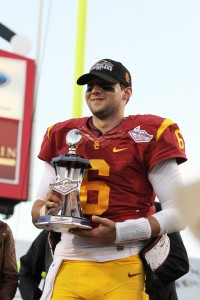 Victorious · Redshirt sophomore quarterback Cody Kessler poses with the Sun Bowl trophy after the Trojans secure their 10th win of the season. – Nick Entin | Daily Trojan