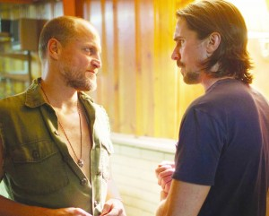Family business · Woody Harrelson (left) is Harlan DeGroat, a cunning meth-addicted mountain man with a volcanic temper. Harrleson's performance as DeGroat is his best since 1994's Natural Born Killers. - Photo courtesy of Relativity Media