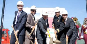 Holes · USC and Los Angeles administrative leaders gather at McAllister Field to participate in the groundbreaking ceremony. - Ralf Cheung | Daily Trojan