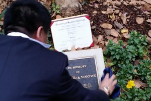Remembrance · The father of Ming Qu, one of the two Chinese graduate students killed off-campus in April 2012, look's over the memorial of his son and Yings Wu near the Viterbi School of Engineering. A tree was planted in honor of the students' deaths at the memorial site. - Courtesy of Daniel Deng