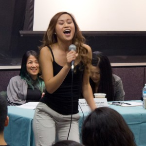 "Karaoke night · Hannah Nguyen, a sophomore majoring in sociology,  sang ""Take Me or Leave Me"" from the   award-winning musical Rent. Nguyen was one of the two student performers for Thursday night's event. - Kevin Fohrer 