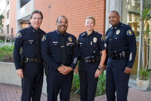 The blues · (Left to right): Deputy Chief David Carlisle, Chief John Thomas, Sergeant Leesa Sandell and Captain Ed Palmer don their new uniforms. The latest editions are a drastic departure from the department's previous tan, beige and green outfits and will provide DPS officers with a sense of uniformity. Austin Vogel | Daily Trojan