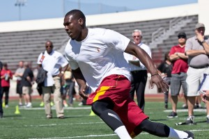 Circus show · Star wide receiver Marqise Lee, who is projected as a first-round draft pick, did not run a 40-yard dash on Pro Day, but participated in multiple sprinting and catching drills for a swarm of scouts. - Joseph Chen | Daily Trojan