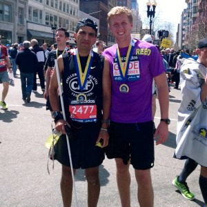 Just keep running · Adrian Broca (left), a blind runner, and Reed Semcken (right), a senior majoring in business administration, pose for a picture after the 2014 Boston Marathon, which was held on Monday, April 21.  - Photo courtesy of Reed Semcken