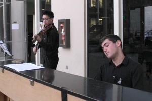 Remember, Unite, Renew · William Liao (left), a junior majoring in health promotion and disease prevention and biological sciences, and Alex Biniaz-Harris (right), a junior majoring in business administration and music, perform at the vigil on April 7. - Christine Yoo | Daily Trojan