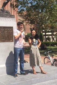 Free speech · SCALE members Matthew Shoemaker and Julia Wang speak in front of Tommy Trojan about their experiences in Tuesday's sit-in.  - Matt Lemas | Daily Trojan