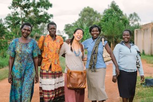 Say cheese · Alice Lee, center, poses with 31 Bits employees outside their office in Gulu, Uganda. Left to right: Grace, Florence, Betty, Jackie. - Photo courtesy of Alice Lee