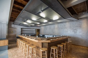 Fancy and functional · KazuNori has created a great setting by blending a central sushi bar and a communal seating area to allow for groups of all types to mingle together while they eat. - Courtesy of KazuNori